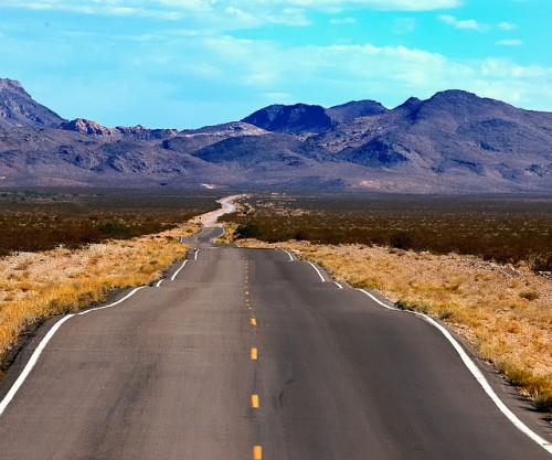 Desert road into the mountains